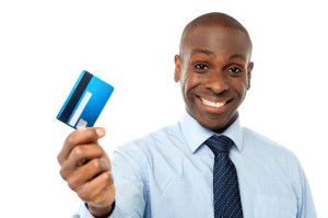 28481893 - smiling corporate man showing his debit card
