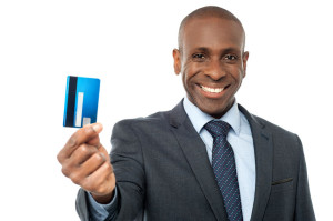 38278264 - young corporate guy showing his debit card