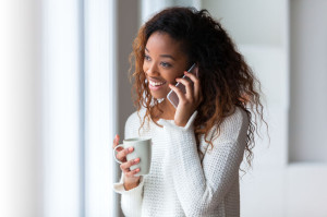 36918488 - african american woman talking on a mobile phone - black people